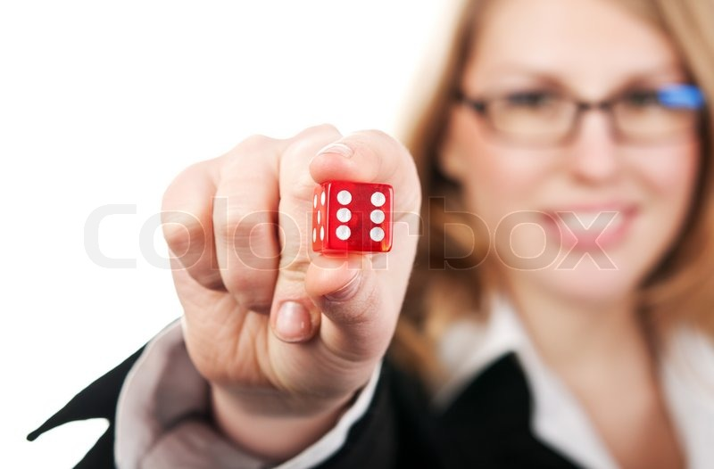 Young beautiful girl holding dice   Stock image   Colourbox