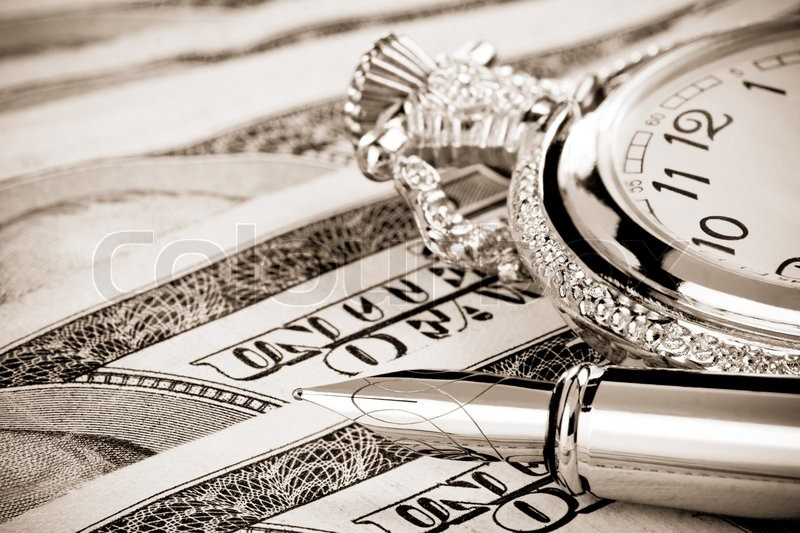 Ink pen and watch on dollar banknotes, stock photo