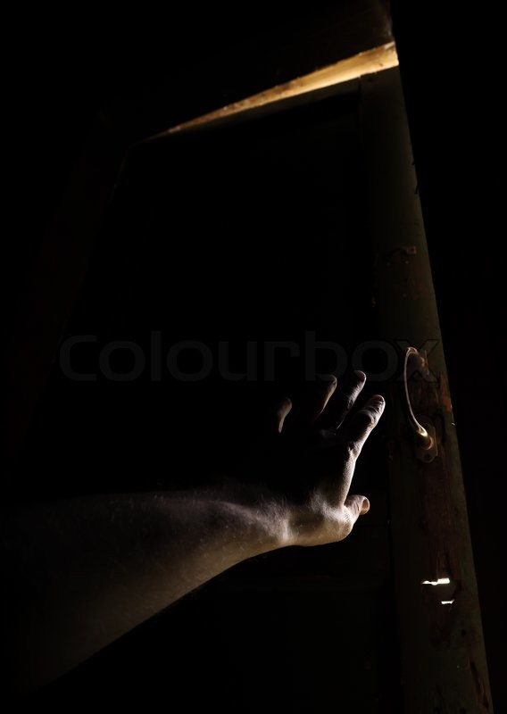 Hand of a man trying to open old door and escape from the dark into the light | Stock Photo | Colourbox & Hand of a man trying to open old door and escape from the dark into ...