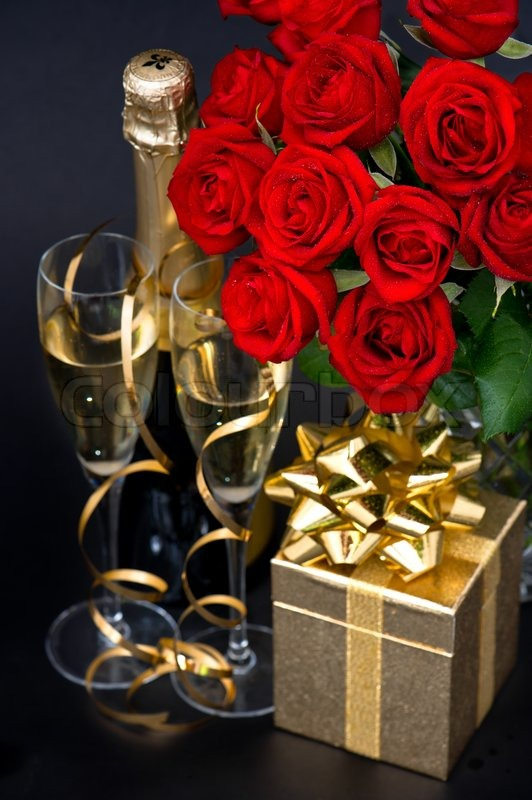 Red Roses Golden Gift And And Champagne Stock Photo
