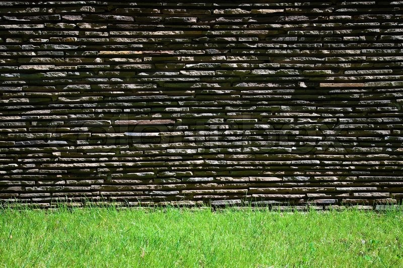 The Wall On The Green Grass Lawn And Brick Wall Stock