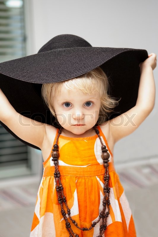 Stock image of cute little girl in black hat