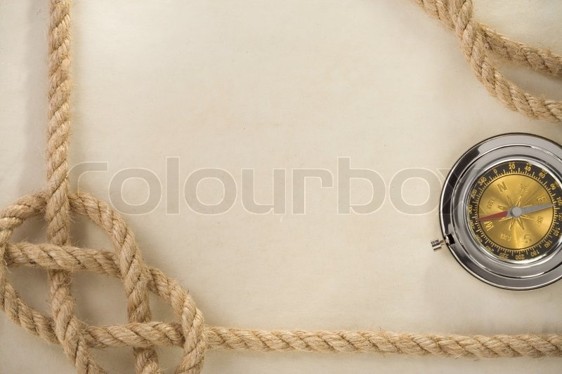 Ropes and compass on old vintage ancient paper background, stock photo