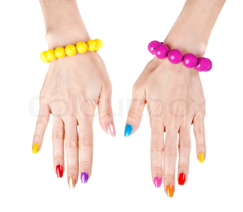 Womens Hands With A Fashionable Multi Colored Nail Polish The Bracelets