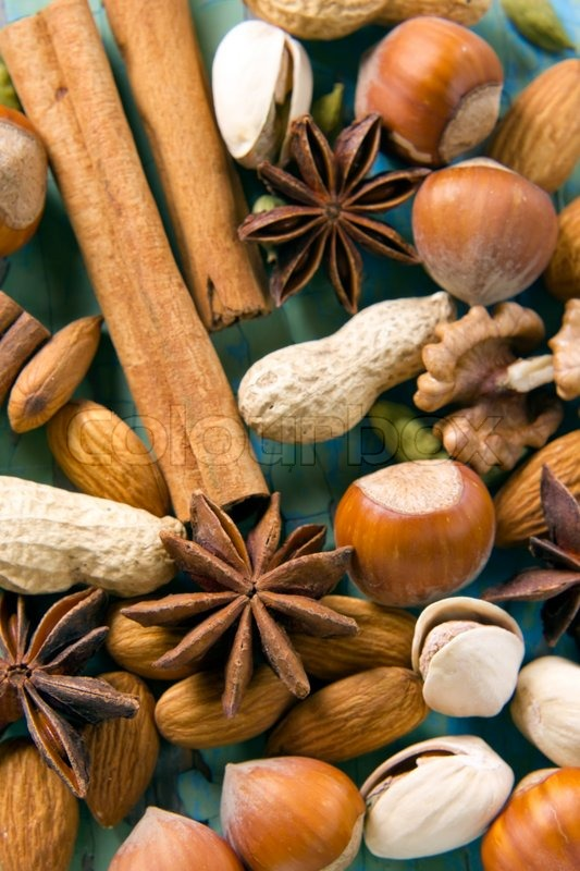 Stock image of 'Aroma spices. Cinnamon, anise, peanuts, almonds, cardamom, hazelnuts on the vintage wooden surface.'
