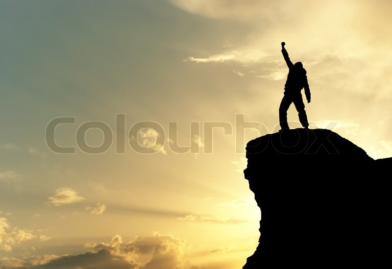 Man on top of mountain, stock photo