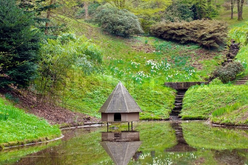 Spring Landscape Pond With A Small House For Wild Birds