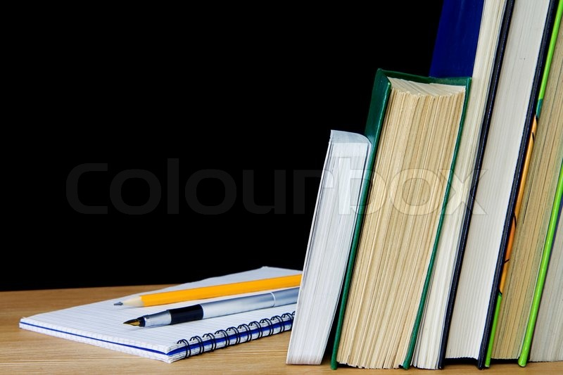 Pen And Pencil On Notebook Near Books Stock Photo