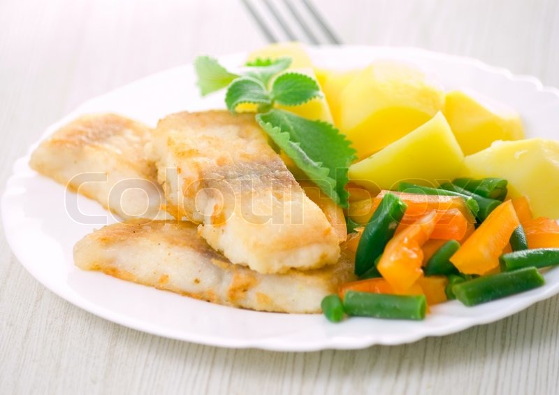 Fried fish with vegetables and potato for dinner stock for What is the best oil to fry fish in