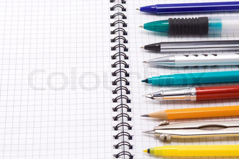 Pen, pencil and felt pen on notebook, stock photo