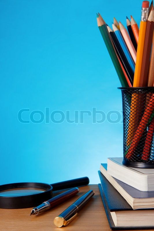 Book Pen With Pencil In Holder Basket Stock Photo