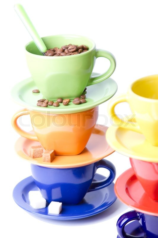 colorful coffee cups spoons sugar and cinnamon stick stock photo