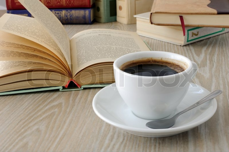 cup of coffee on a table with books | stock photo | colourbox