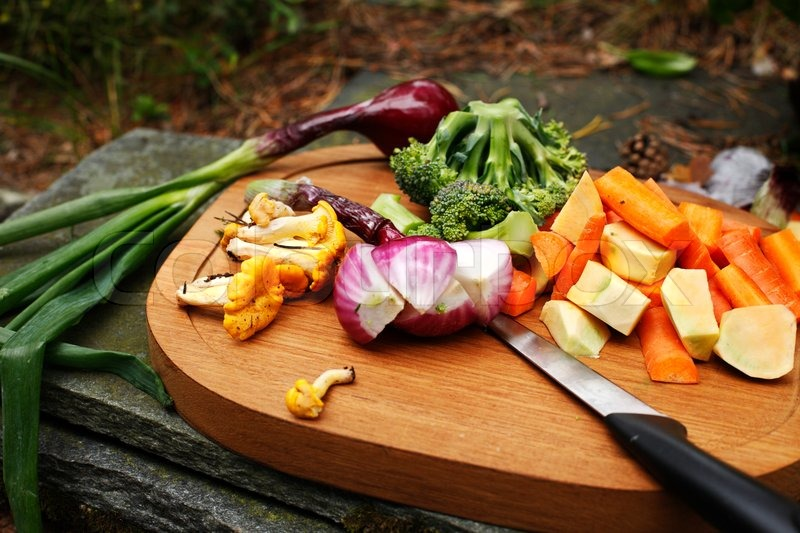 Veggies And Chanterelles On Cutting Board In The Garden | Stock Photo |  Colourbox