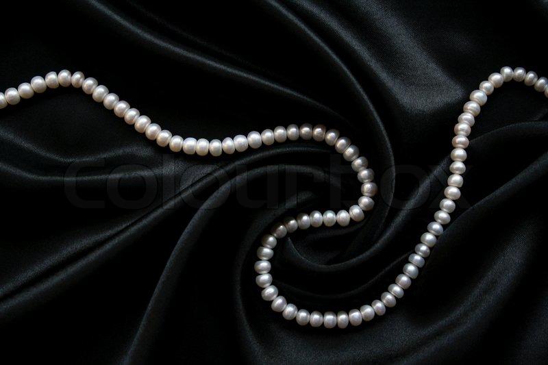 Stock Image Of White Pearls On The Black Velvet Background