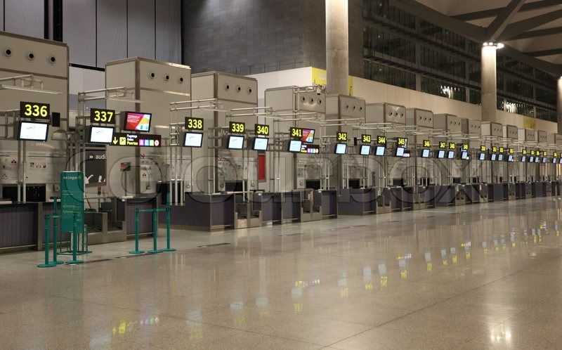 Empty airport check-in counters in Malaga, Spain Photo taken at 23rd of July 2012, stock photo