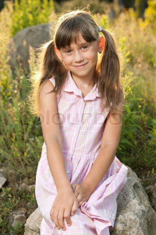 Pretty Cute Girl Sitting  Stock Photo  Colourbox-4215