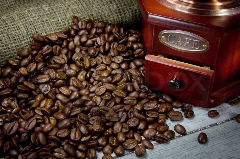 Beans and wood coffee grinder, stock photo