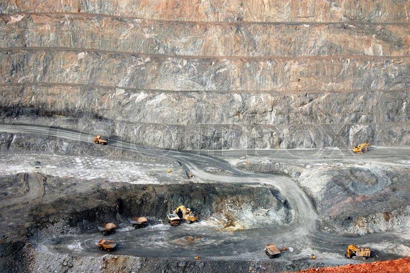 Trucks in Super Pit gold mine Australia, stock photo