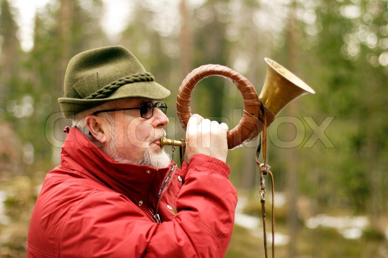 Close Up Of Hunter Blowing The Hunting Horn Stock Photo