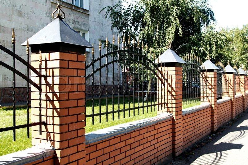 Fence metal brick nature Stock Photo Colourbox