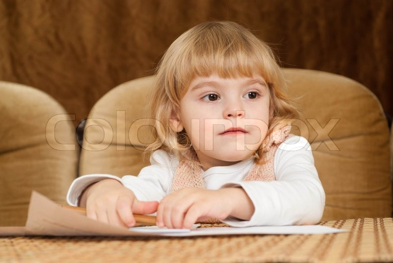 Good Caucasian young baby draws a table, stock photo