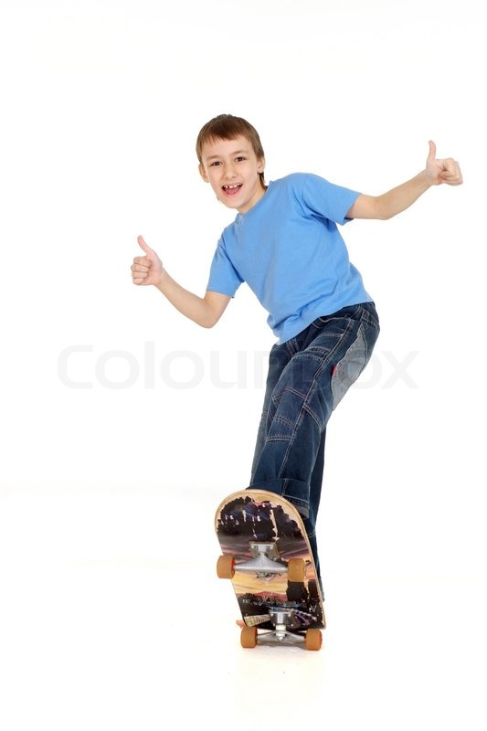 Boy standing on skateboard | Stock Photo | Colourbox