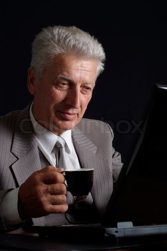 Imposing old man in suit with a cup of coffee stock photo colourbox publicscrutiny Images