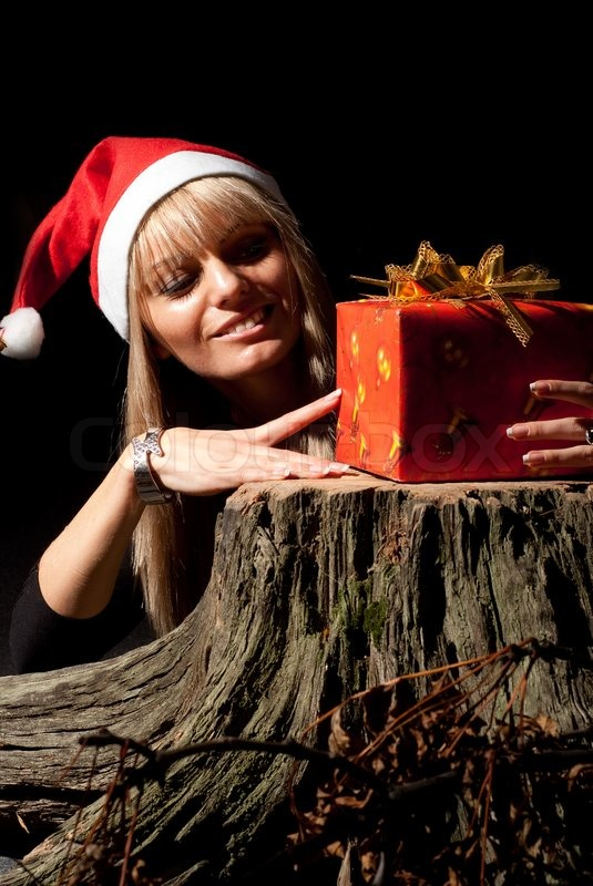 Girl with xmas present, stock photo