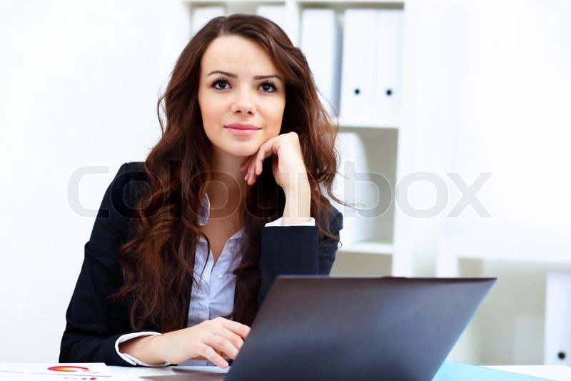 business woman with notebook in the office | Stock Photo | Colourbox
