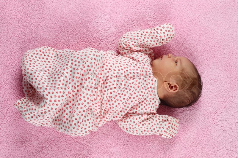 43b454d1f036 Cute newborn baby girl on pink blanket