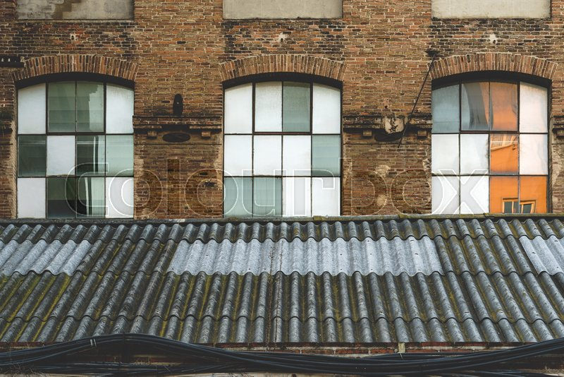 Windows and worn-out roof of an old ... | Stock image ...