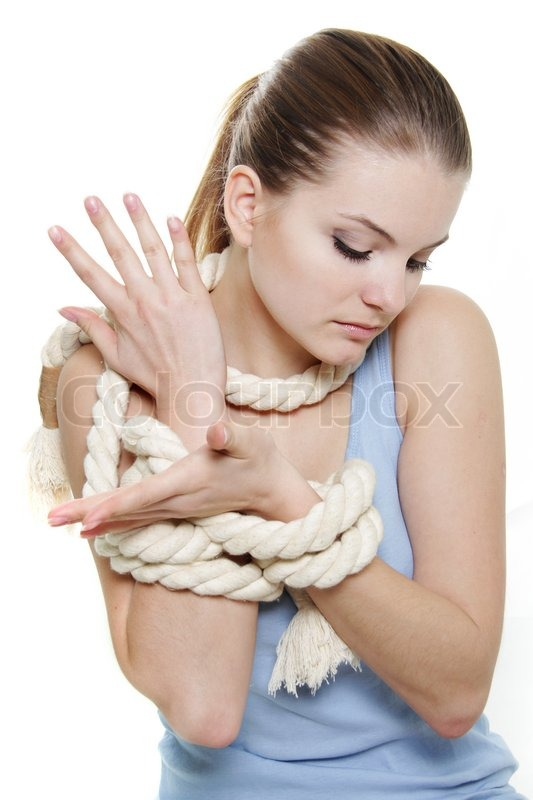 Young woman tied up woth rope over white | Stock Photo ...