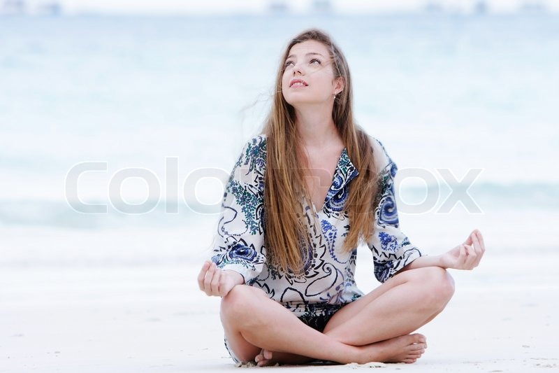 Young Beautiful Woman Meditating On Stock Image Colourbox