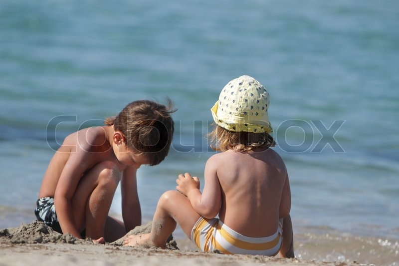 Stock image of 'two children playing on beach'