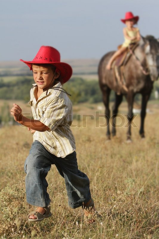 Two happy children riding horse on ...  44903619f47f
