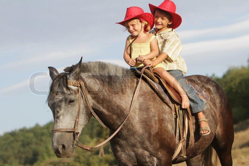 Two happy children in cowboy hats ...  269e1b074f78