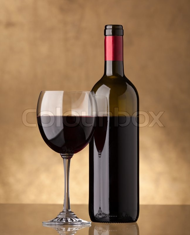 A bottle of red wine and filled a wine glass stock photo for Glass bottles for wine