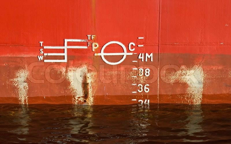 Stock image of 'Cargo ship red hull texture with waterline and scale of draft'