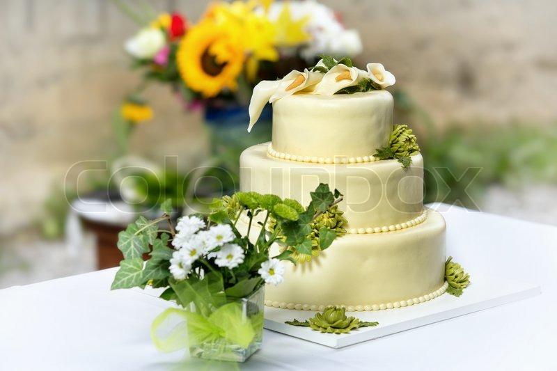 Traditional wedding cake with chrysanthemum flowers | Stock Photo ...