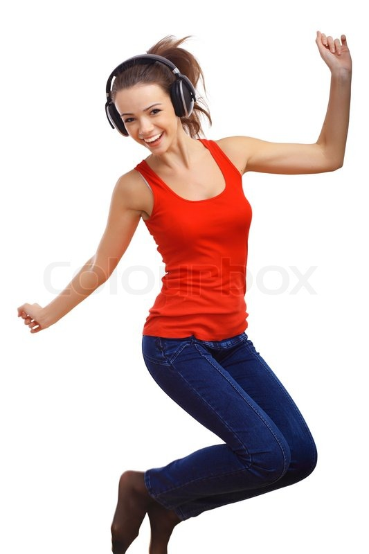 happy smiling girl dancing and listening to music stock