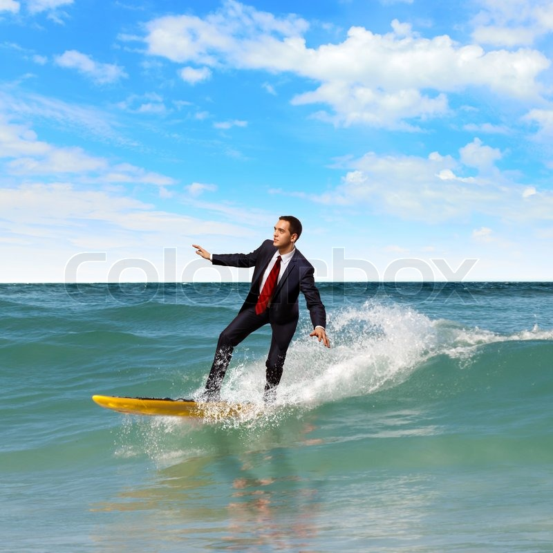image of young business person surfing on the waves of the