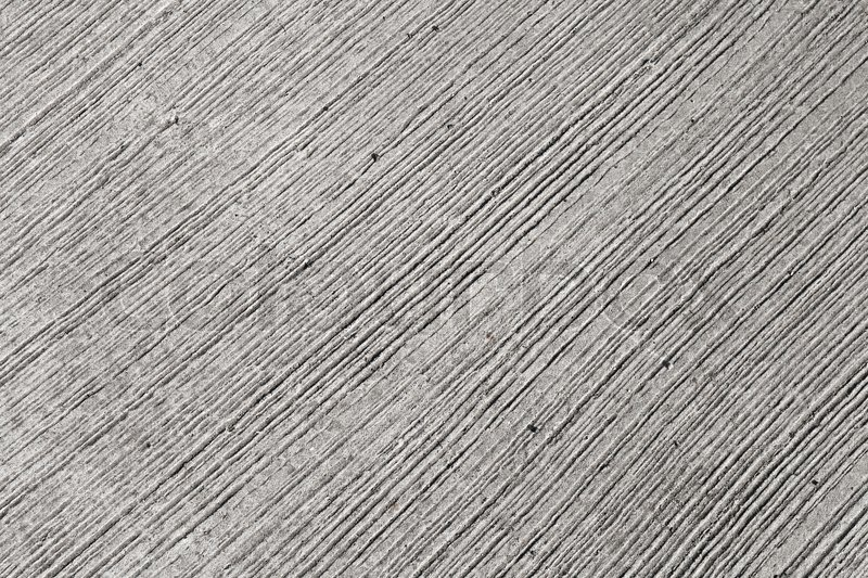 Line Texture Photo : Closeup rough gray concrete wall texture with relief lines