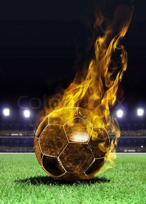 Fiery soccer ball on field at night   Stock Photo   Colourbox