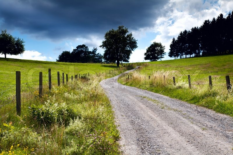 Countryside Road With Fence Stock Photo Colourbox