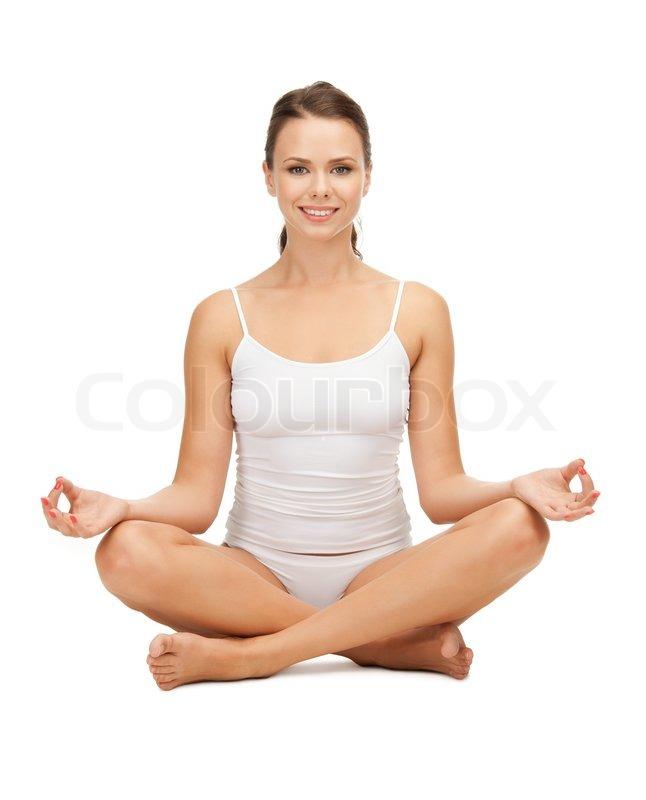 Woman Practicing Yoga Lotus Pose