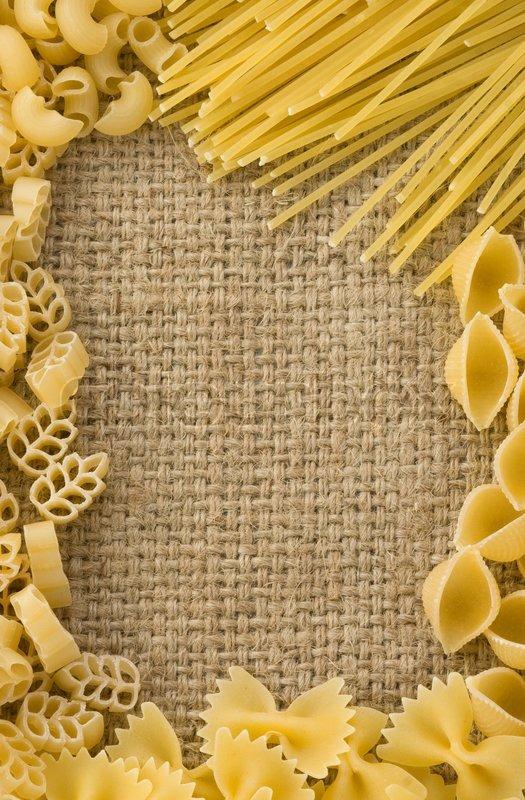 Raw Pasta On Sack Burlap Background Texture Stock Photo