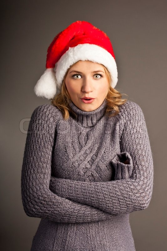 Santa christmas woman in sweater isolated on white background, stock photo