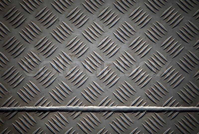 Closeup Texture Of Diamond Metal Plate With Joint Stock