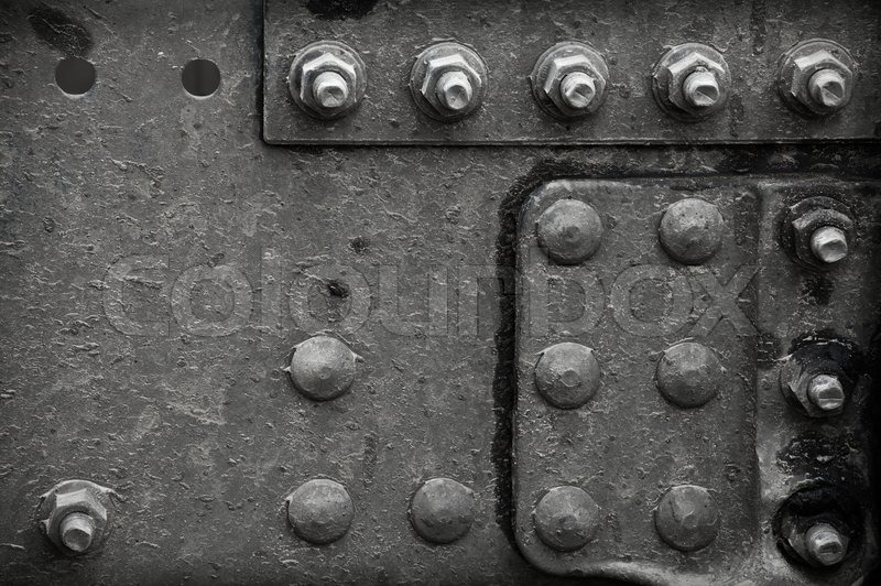 Stock image of 'Black steel structure with bolts and rivets'